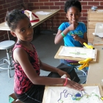 Kids learning Mardi Gras Indian design at Xavier's art program